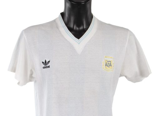 Match-worn tops once belonging to the late football superstar Diego Maradona were among a trove of sports memorabilia sold at auction (Julien's Auctions/PA)
