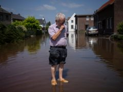 Wiel de Bie, a 75-year-old stands outside his flooded home in the town of Brommelen, Netherlands (Bram Janssen/AP)