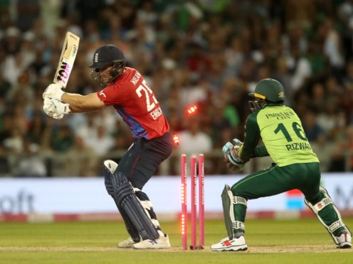 England's Dawid Malan is dismissed during the Twenty20 International match at the Old Trafford Cricket Ground, Manchester. Picture date: Tuesday July 20, 2021.