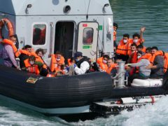 A group of people thought to be migrants are brought in to Dover, Kent, onboard a border force boat following a small boat incident in the Channel (Gareth Fuller/PA)