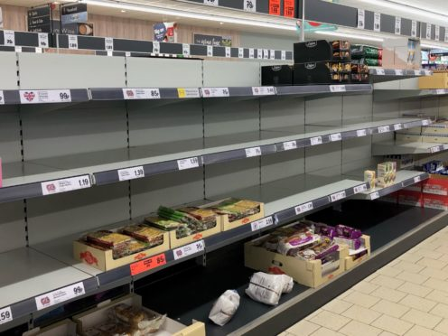 Empty shelves in the Lidl at Pity Me, Durham (Tom Wilkinson/PA)