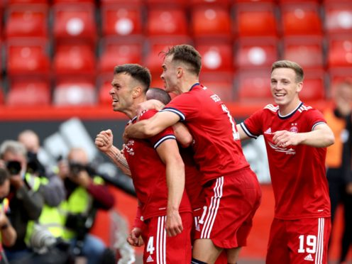 Andy Considine celebrates his opener in front of the Aberdeen fans (Steve Welsh/PA)