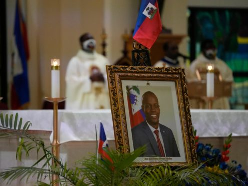 A photograph of Haiti's assassinated President Jovenel Moise is displayed during a memorial service at Notre Dame d'Haiti Catholic Church in the Little Haiti neighbourhood of Miami (Rebecca Blackwell/AP)