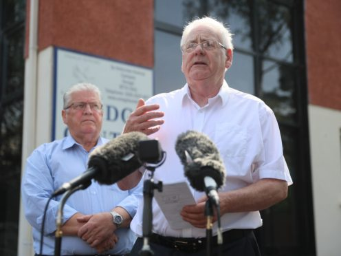 Stanley McCombe (left), who lost his wife Ann, and Michael Gallagher who lost his son Aiden in the Omagh bombing (PA)