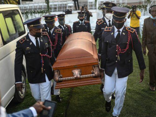 Police carry the coffin of murdered Haitian president Jovenel Moise (Matias Delacroix/AP)