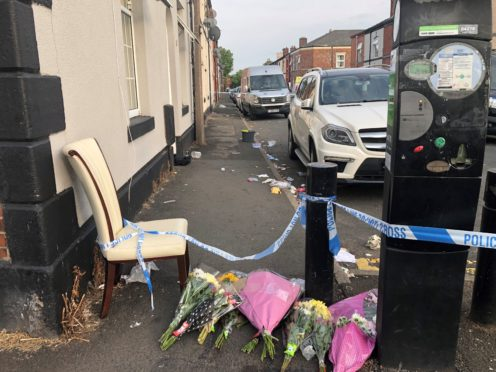Flowers left at East Street in Bury, Greater Manchester, where a 31-year-old woman died from severe burns (Kim Pilling, PA)