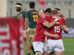British and Irish Lions' Conor Murray (left), Stuart Hogg (15) and Owen Farrell celebrate after a 22-17 victory over South Africa in the first Test (Halden Krog/PA)