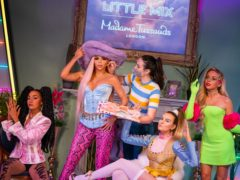 A staff member puts the finishing touches to the wax figures of Little Mix (Aaron Chown/PA)