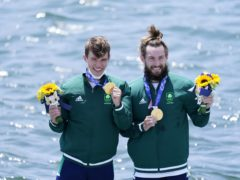 Fintan McCarthy and Paul O'Donovan on the podium following their Olympic win (Danny Lawson/PA)
