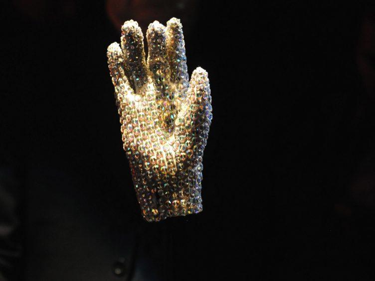 A glove worn by Michael Jackson to the 1983 Grammy Awards (Zak Hussein/PA)