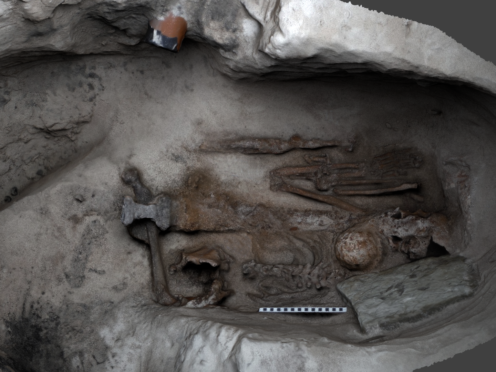 Still from a 3D model showing the excavation of Mayback III, a pagan Norse grave (AOC Archaeology/PA)