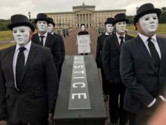 Victims hold a staged funeral procession at Stormont in protest at Government plans over legacy in Northern Ireland (Jonathan McCambridge/PA)