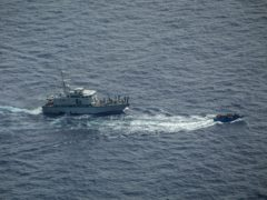 An overcrowded migrant boat, right, tries to escape from the Libyan coast guard in the Mediterranean Sea (Sea-Watch.org via AP)