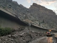 Equipment works to clear mud and debris from a mudslide on Interstate-70 through Glenwood Canyon, Colorado (Colorado Department of Transportation via AP)