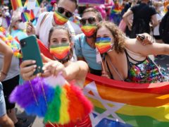 People take part in the Christopher Street Day parade in Berlin (dpa/AP)