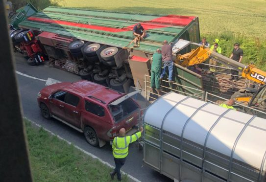 Cattle float with dozens of cows on board on its side in Perthshire crash