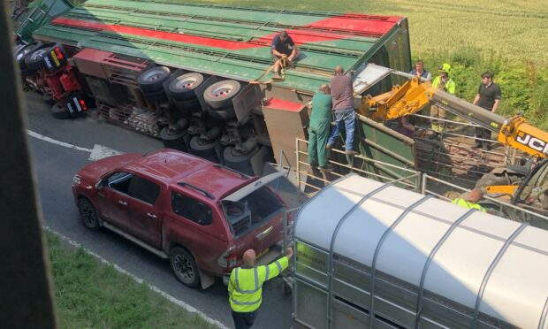 Driver taken to hospital after cattle truck overturns on Perthshire road