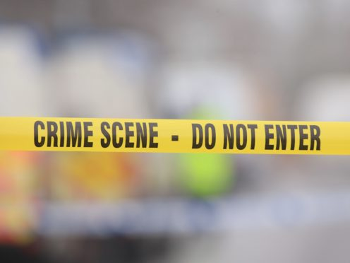 A generic stock photo of crime scene tape (Peter Byrne/PA)