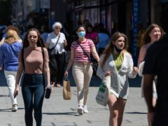 Shoppers on Oxford Street in central London (PA)