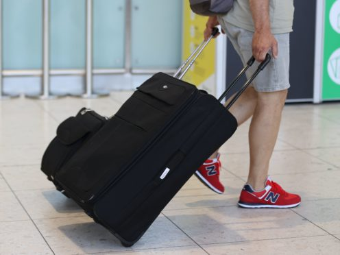 Holidaymakers can travel abroad without 'looking over their shoulders' in fear of being caught out by changing rules, Transport Secretary Grant Shapps has claimed (Liam McBurney/PA)