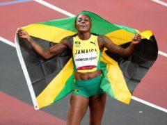 Jamaica's Elaine Thompson-Herah, who has won the 100m and 200m double, celebrates in the Olympic Stadium