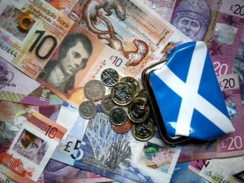 About three-quarters of Scottish firms are planning a pay review (Jane Barlow/PA)