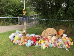 Tributes left in Pandy Park in Bridgend, South Wales, near to where a five-year-old boy was found dead in the Ogmore River (Claire Hayhurst/PA)