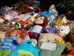 Tributes left at the scene in the Sarn area of Bridgend, south Wales, near to where five-year-old Logan Mwangi was found dead in the Ogmore River (Ben Birchall/PA)