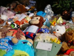 Tributes have been left by the river (Ben Birchall/PA)