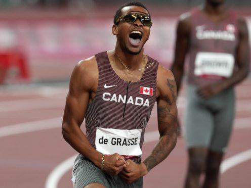 Canada's Andre De Grasse celebrates gold in the 200m. (Martin Rickett/PA)