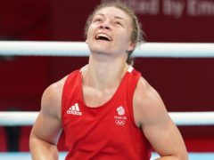 Great Britain's Lauren Price celebrates victory over Holland's Nouchka Fontijn in their middleweight semi-final (Martin Rickett/PA Images).