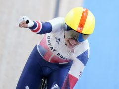 Great Britain's Laura Kenny celebrates winning gold in the women's Madison (Danny Lawson/PA)