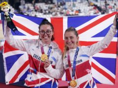 Great Britain's Katie Archibald, left, and Laura Kenny celebrate with their gold medals after winning the women's Madison final (Danny Lawson/PA)