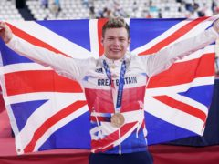 Great Britain's Jack Carlin celebrates on the podium with his bronze medal (Danny Lawson/PA)