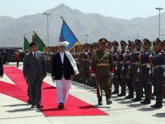 President Ashraf Ghani inspecting troops earlier this month (Rahmat Gul/AP)