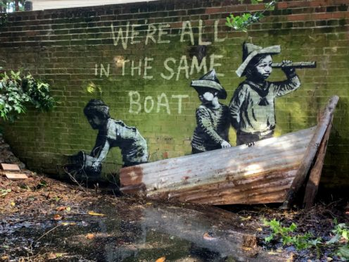 Street art which has appeared on a wall in Nicholas Everitt Park (PA)