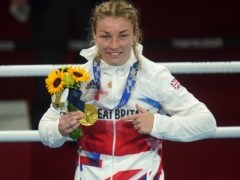 Great Britain's Lauren Price celebrates gold after defeating China's Qian Li in the women's middleweight final (Adam Davy/PA Images).