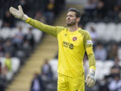 Both managers sung the praises of Craig Gordon after Hearts' win over Dundee United (Jeff Holmes/PA).