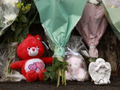 Flowers and soft toys left at the scene in Dungannon, Co Tyrone, where a two-year-old who was found injured on Friday afternoon was rushed to hospital and later died (Liam McBurney/PA)