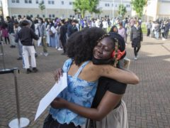 Students celebrate at Brampton Manor Academy in London (Rick Findler/PA)