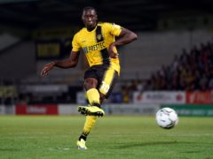 Lucas Akins' late penalty secured victory for Burton (Jacob King/PA)