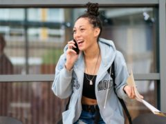 Cyan Benjamin-Neita shares news of her GCSE results by phone at Ark Burlington Danes Academy in west London (Dominic Lipinski/PA)