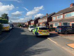Police at the scene in Cairndhu Drive in Kidderminste (Josh Payne/PA)