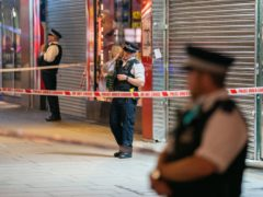 Metropolitan Police officers at the scene on Oxford Street, London, where a man was found just after 7pm with multiple stab wounds (Dominic Lipinski/PA)