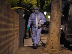 A police officer in a forensic suit at the scene in St Luke's Road, Notting Hill (Kirsty O'Connor/PA)
