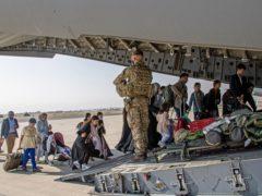 British citizens boarding an RAF aircraft at Kabul airport (Ben Shread/MoD/PA)