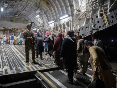 Afghan passengers board a US plane in Kabul (MSgt Donald R Allen/US Air Force via AP)