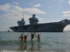 Bathers welcome home the HMS Prince of Wales aircraft carrier to Portsmouth (Ben Mitchell/PA)