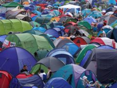 Festivalgoers relax at the Reading Festival (Kirsty O'Connor/PA)