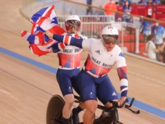 Great Britain's Neil Fachie and his pilot Matthew Rotherham (front) celebrate their victory in the men's B 1000m time trial at the Izu Velodrome (PA Wire via DPA)